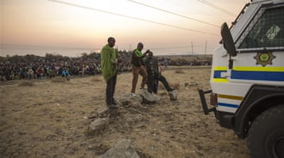 Thirty-four miners were killed when police opened fire on protesters at the Marikana mine [Siphiwe Sibeko/REUTERS]