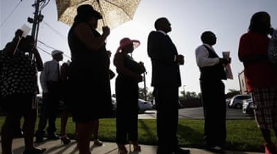 People wait in line to attend the funeral for Michael Brown St. Louis, Missouri [Reuters]