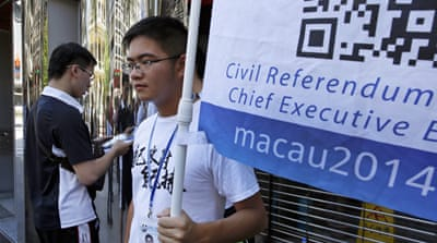 Activists in Macau kicked off an informal poll on Sunday to gauge support for democratic reforms [AP]
