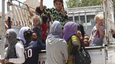 Kurds rescue Yazidis from Iraqi mountain