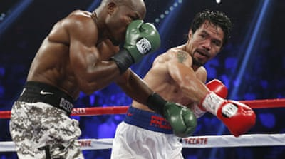 Boxer Manny Pacquiao is the first fighter in history to bag eight world titles in as many weight divisions [AP]