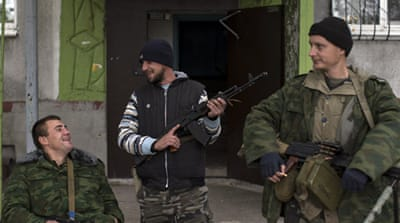 Ukraine troops and rebels 'begin withdrawing'