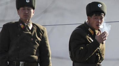 Kang Sok-ju, right, appears to be part of a new diplomatic offensive aimed at better international relations [AP]