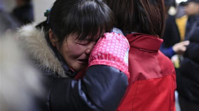 Shanghai New Year's stampede kills dozens