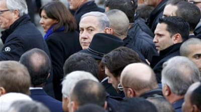 Netanyahu takes part with dozens of foreign leaders in a solidarity march in the streets of Paris [Reuters]