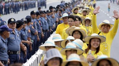 Church bells rang throughout the Philippines to welcome the pope as he set foot at the Manila airport [EPA]