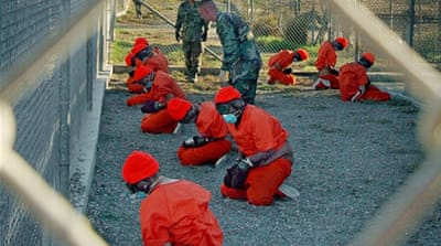 An estimated 122 prisoners are still incarcerated at Guantanamo Bay [AP]