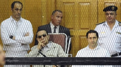 Alaa and Gamal Mubarak left jail early on Friday after a court ordered their release, local media reports said [AP]