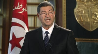 Essid said he had formed the cabinet of the new government without appointing any members of Ennahda [Reuters]
