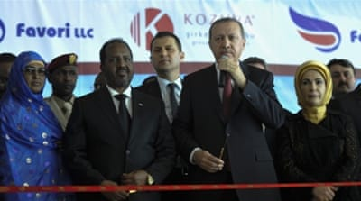 "Erdogan praised the ""major developments"" seen in Somalia, after being welcomed at the capital's new Turkish-renovated airport [Reuters]"