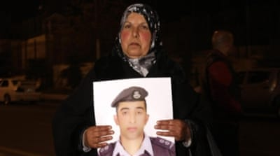 About 200 relatives of captured Jordanian pilot protested outside the prime minister's office in Amman [AP]