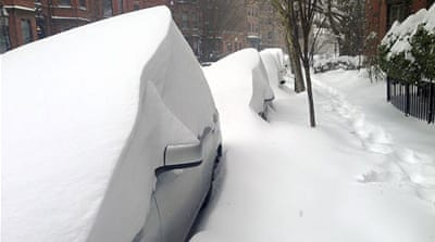 Cars were buried by drifted snow along Marlborough Street in Boston [AP]
