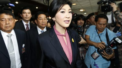Yingluck told the National Assembly, the scheme helped poor farmers and alleviated poverty [EPA]