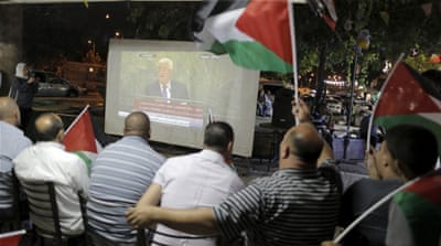 Palestinians have gathered in occupied East Jerusalem to watch PA President Mahmoud Abbas [Reuters]