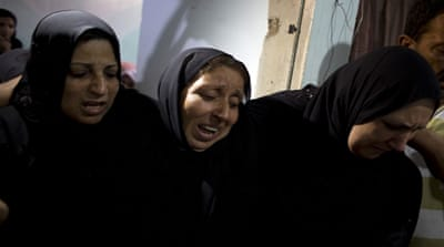 Pregnant Palestinian woman killed in air strike buried