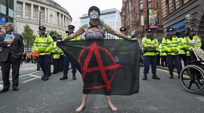 Protesters take part in a 'Disabled People Against Cuts' anti-austerity demonstration in London in July [Matt Dunham/AP]