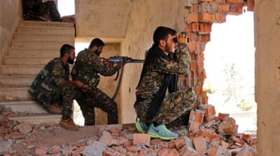 Backed by US air power Kurdish groups have made gains against ISIL [AP]
