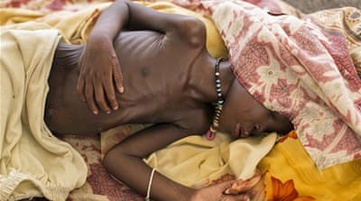 'At least 30,000 people are living in extreme conditions and are facing starvation and death' [Matthew Abbott/AP]