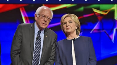 Hillary Rodham Clinton looks on as Bernie Sanders speaks during the Democratic presidential debate on Tuesday in Las Vegas [John Locher/AP]