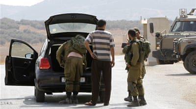 An assailant shot and killed the parents, who were driving with their children in the West Bank [Majdi Mohammed/AP]