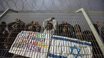 Migrants from Eritrea take part in a protest outside the European Union delegation in Israel in June [Baz Ratner/Reuters]