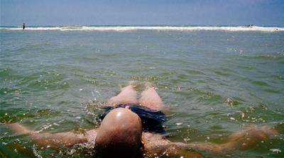 Jennifer floats in the ocean the summer before she passed away. [Angelo Merendino/Al Jazeera]