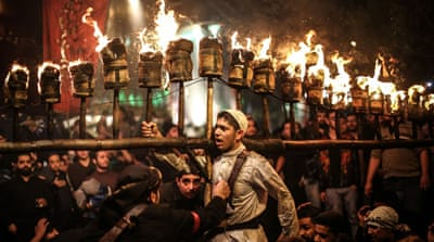 Torches light up Tehran on eve of Ashoura