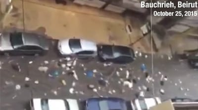 Video: Garbage streams down streets of rainy Beirut