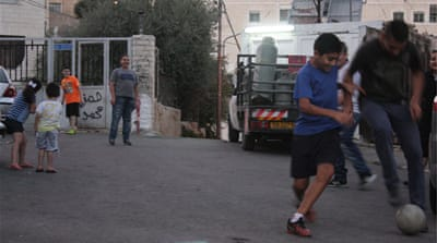 Zamzam S and his brother, Khalil, said they were arrested last week while playing football in the street [Ylenia Gostoli/Al Jazeera]