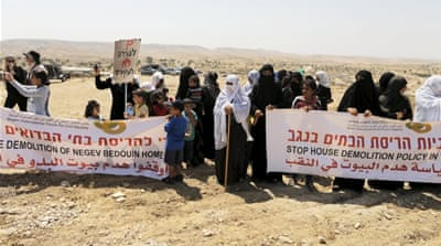 Palestinian women protest against home demolitions in the 'unrecognised villages' of Israel's Negev region [Reuters]