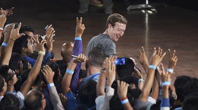 Modi and Zuckerberg at Facebook's headquarters last September [Jeff Chiu/AP Photo]