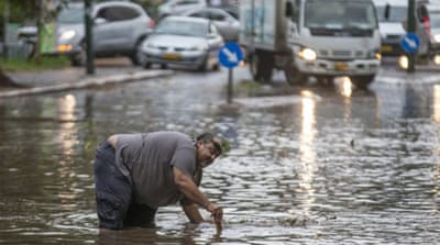 Heavy rain leaves widespread flooding across parts of Syria, Iraq, Iran and Kuwait [AFP]