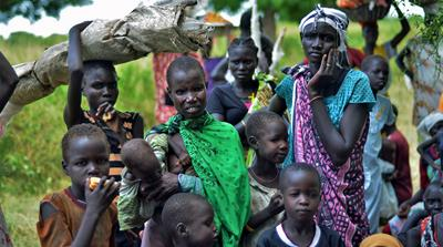 Women wait to receive food aid in Koch town of war-torn Unity state [Jason Patinkin/Al Jazeera]