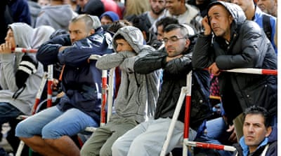Arduous wait for refugees in overwhelmed Germany