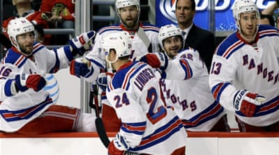 Rangers hand Blackhawks an opening-day defeat
