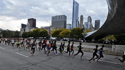 Team Palestine runs in the Chicago Marathon to raise awareness for the Palestinian cause [Nam Y Huh/AP]