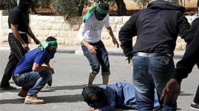 A wounded Palestinian lies on the ground after clashes in the West Bank [Reuters]