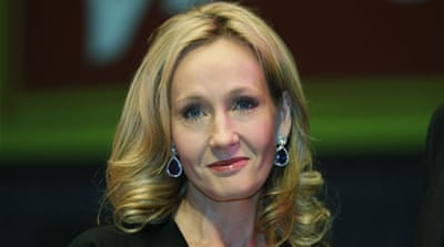 Rowling hands the sorcerer's stone to the occupation