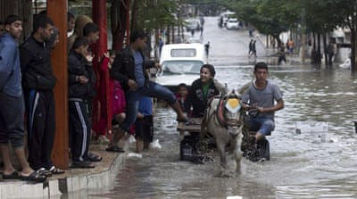 Flash floods hit Khan Yunis in the Gaza Strip. Many parts of the neighbourhood were left underwater [AFP]
