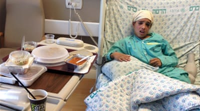 Manasrah, 13, was admitted to hospital after being struck by a car after he and his cousin allegedly stabbed two Israelis [Reuters/GOP]