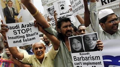 Sri Lankans protest to demand a pardon for Rizana Nafeek, who was later beheaded in Saudi Arabia [Eranga Jayawardena/AP]
