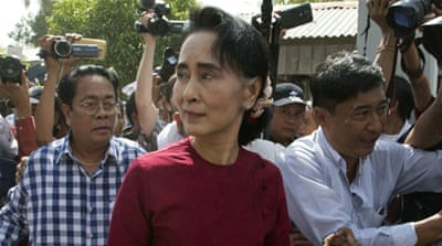 Suu Kyi is barred from taking the presidency under a constitution written by the military government to preserve its power [Associated Press]