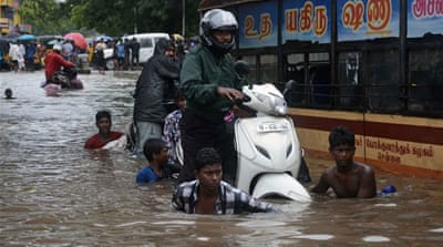 The deluge brought Chennai to a standstill, making many of the roads impassable [AFP]