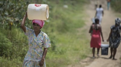 Water in some parts of South Africa has been rationed, meaning residents have to collect their supplies from tankers [EPA]