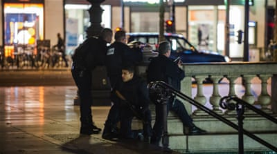Police have so far arrested at least 23 people after raids in Brussels and France [AP]