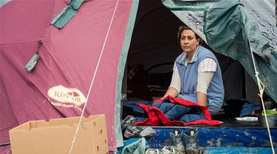 Calais refugees grieve for Paris, dread backlash