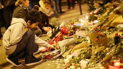 Flowers and candles were laid across the globe in tribute to the victims of the November 13 Paris attacks [Ian Langsdon/EPA]