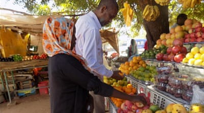 On the streets of Sudan: Dreaming of riches and apples