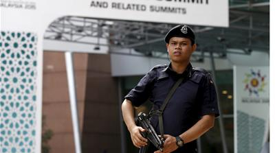 Members of the military and police patrol outside the ASEAN venue in Kuala Lumpur on Friday [Olivia Harris/Reuters]