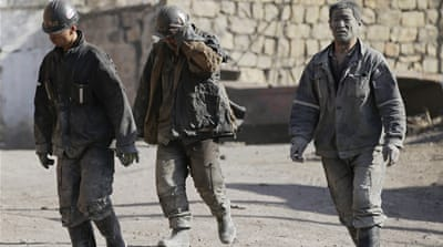 Miners walk out of a coal mine on the outskirts of Jixi city in Heilongjiang province [File: Jason Lee/Reuters]